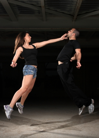 black empowerment: martial arts female instructor exercising with young man