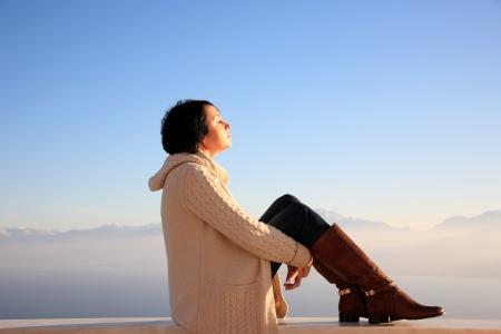 beautiful young girl enjoying the sun in top spot of a mountain Stock Photo