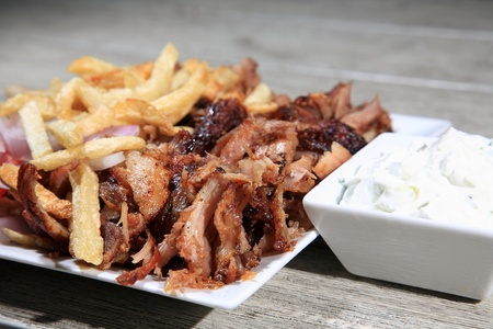 gyros: close up of kebab served on a plate with fried potatoes Stock Photo