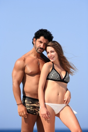 portrait of a beautiful young couple at the beach photo