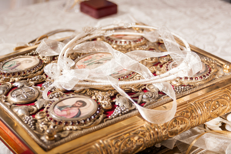 closeup of wedding crowns decorated on a gospel