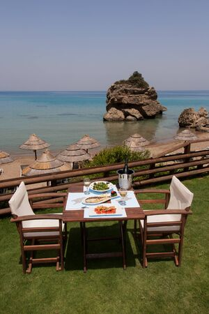 healthy seafood on a table for two by the sea photo