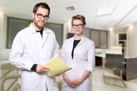 portrait of young couple doctors in a medical center Stock Photo