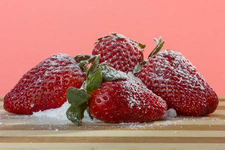 strawberies: closeup of fresh strawberries with sugar powder on top