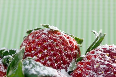 strawberies: closeup of fresh strawberries with sugar powder on top