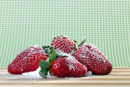closeup of fresh strawberries with sugar powder on top  photo