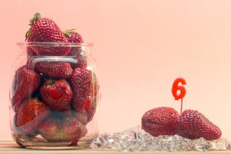strawberies: fresh strawberries with birthday candles sticks