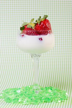 strawberies: fresh strawberries on a glass filled with cream  Stock Photo