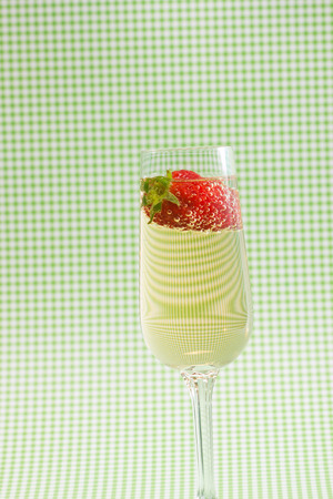 strawberies: fresh strawberry on a glass filled sparkling wine