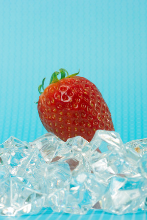 strawberies: fresh strawberry on ice and blue background