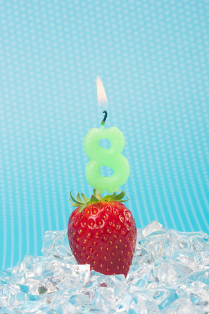 strawberies: fresh strawberry with birthday number candle