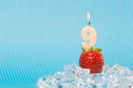 fresh strawberry with birthday number candle  photo
