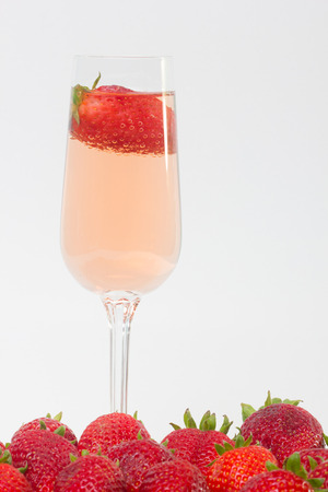 strawberies: fresh strawberry on a glass filled with wine