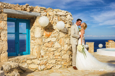 portrait of a bride and groom in a greek island on their wedding day Stock Photo