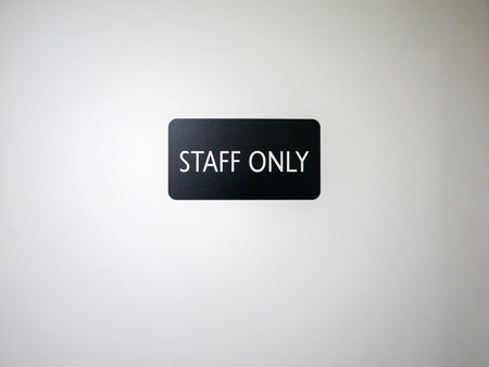 closeup of staff only sign on a door of a company photo
