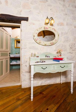 luxury apartment: bedroom interior of a luxury traditional stone apartment Stock Photo