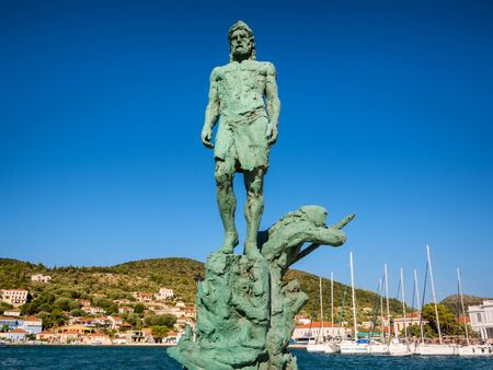 ionio: the statue of Odysseus at the port of Ithaca island Stock Photo