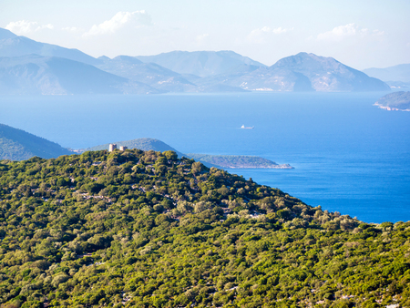 ionio: old windmills on the top of a hill in Ithaca island in Greece