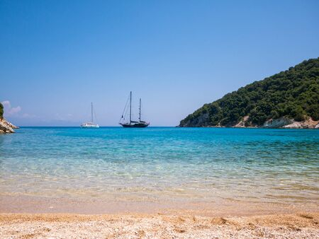 ionio: panoramic view of a beach with big sail boat in Ithaca island in Greece Stock Photo