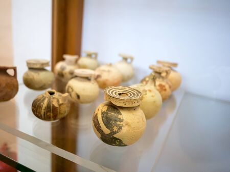 greek pot: small ancient clay pots in the national museum of Ithaca