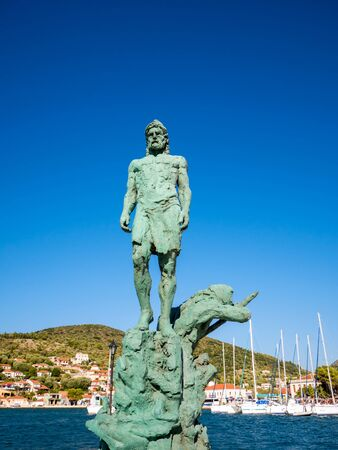 ionio: the new statue of Odysseus at the port of Ithaca island Stock Photo