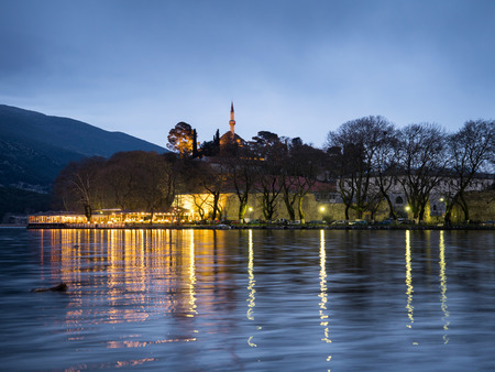 the lake of Ioannina at dawn with street and lights,Greece Stock Photo