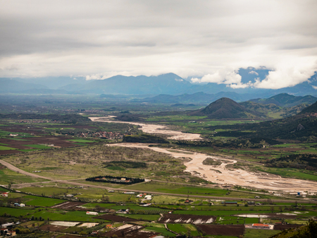 flooded: landscape of  a flooded river and near kalabaka town  in north Greece Stock Photo