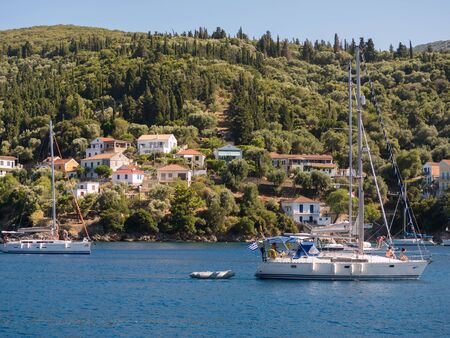ionio: sailing boats with tourists visiting the beautiful island of Ithaca July 27 2015, Greece Stock Photo