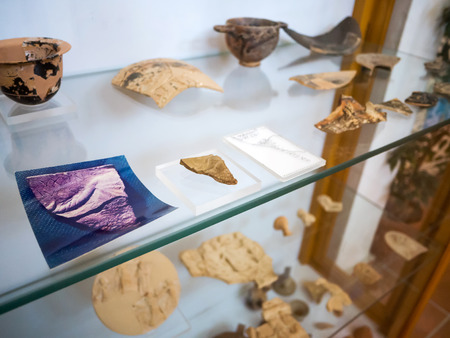 artifacts: small ancient artifacts from the period of odysseus found inside a cave and now stored in the national museum of Ithaca July 28th 2015, Greece Editorial