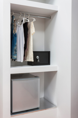 safe lock: wardrobe safe lock and mini bar of a room in a hotel Stock Photo