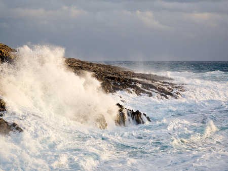 big waves: sea with big waves crashing on the rocks after storm