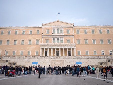 ATHENS,GREECE - MARCH 26, 2016: Tourists watching the presidential guards in front of the Greek parliament