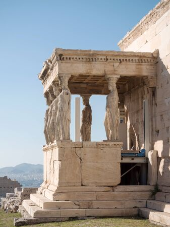 The Erechtheum with caryatids near Parthenon temple in Acropolis hill