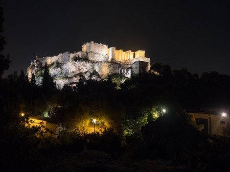 iluminated: The Acropolis hill with the temple of Parthenon iluminated against the dark sky