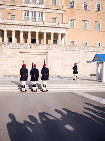 admiring: Athens, Greece - March 28, 2016: Crowd admiring and photographing the changing of the honor Presidential guards ceremony in front of the Tomb of the Unknown Soldier in Syntagma Square, Athens, Greece.