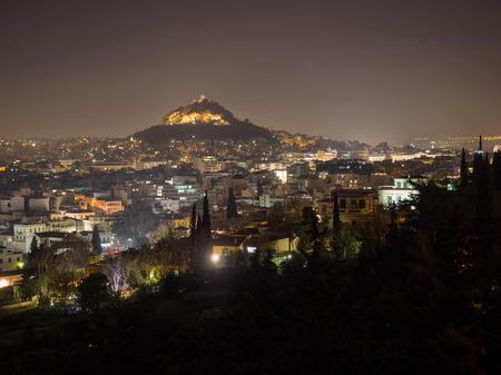 iluminated: Panoramic view of Athens city and Lecabetus hill at night