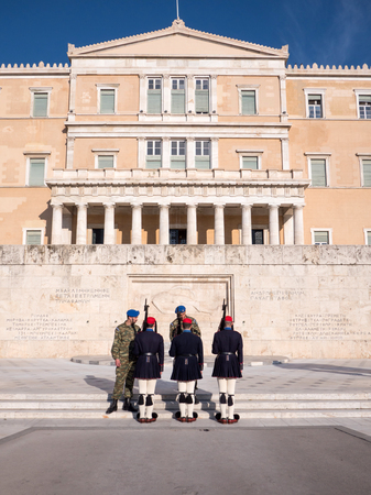 unknown men: Athens, Greece - March 28, 2016: Crowd admiring and photographing the changing of the honor Presidential guards ceremony in front of the Tomb of the Unknown Soldier in Syntagma Square, Athens, Greece.