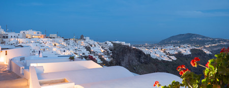 Small white houses with lights late in the afternoon in Santorini island in Cyclades,Greece