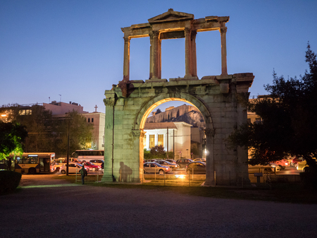 Hadrians gate illuminated at night with Acropolis on the background in the historic center of Athens, Greece Editorial