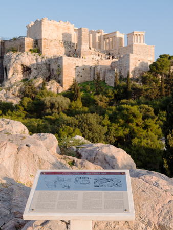 Informative sign of Areopagus and Acropolis hill in the background,Athens, Greece 写真素材