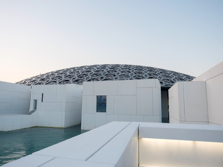 Abu Dhabi, United Arab Emirates - December 20, 2017: The exterior of Louvre museum with modern design in Abu Dhabi