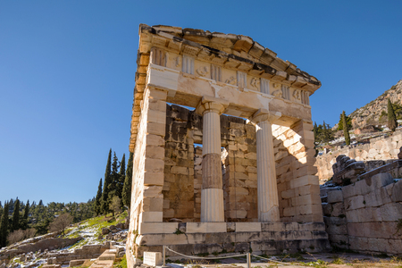 Ruins of Athenian Treasury in Delphi archaeologiacal site in Greece