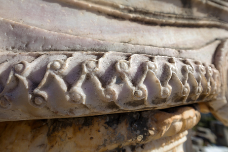 Close up of carved column from marble in Delphi archaeological site in Greece Reklamní fotografie - 121296461