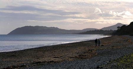 Couple walking on Killiney Bay photo