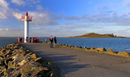 View from the Howth Harbour with Irelands Eye in the background. photo