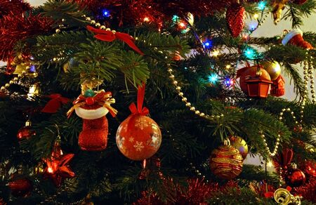 Real Christmas tree with decorations and bulbs photo