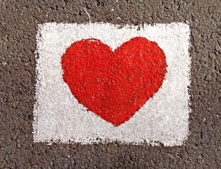 Red heart painted on the road Stock Photo - 5282431