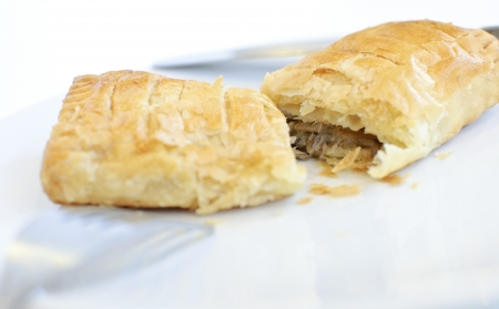 Puff pastry with tuna on white background photo