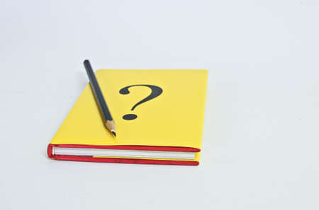 Question book with pencil on white background photo