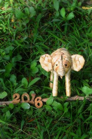 new beginning: Happy New Year 2016 concept, elephant rattan handmade and wood number idea